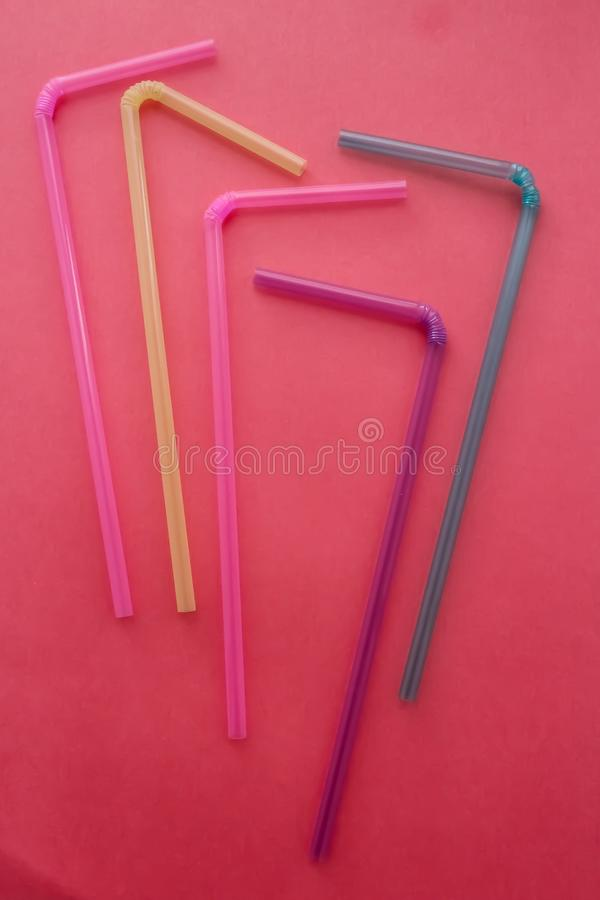 Colored tubes for drinks stock image