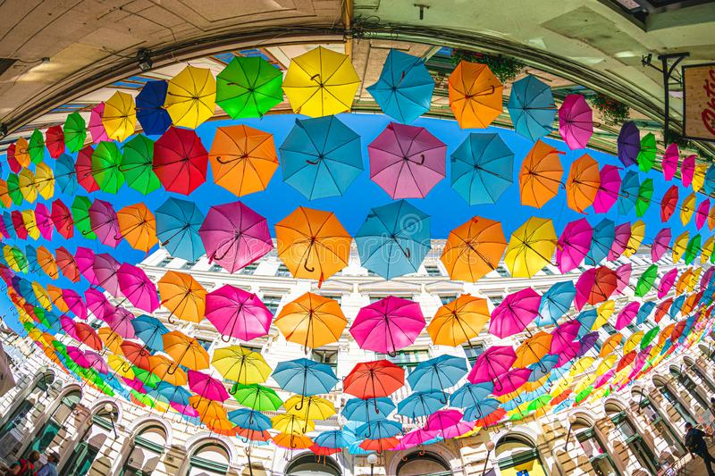 Colored umbrellas hanging between buildings, festival days in Timisoara, Romania JULY 4, 2019.  royalty free stock photo