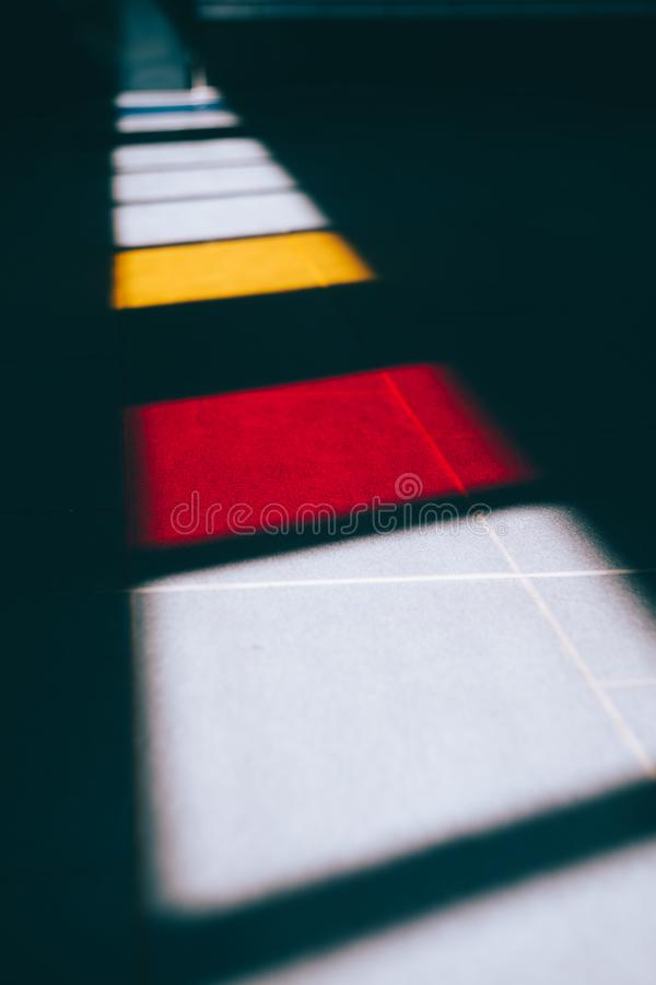 Colored windows light on the ground of an subway royalty free stock images