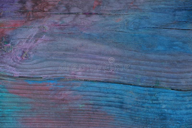 Colored wooden background from an old board stock photography