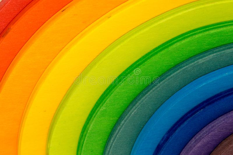 Colored wooden building blocks - abstract. Abstract colored wooden building blocks - rainbow colors - round shape stock image