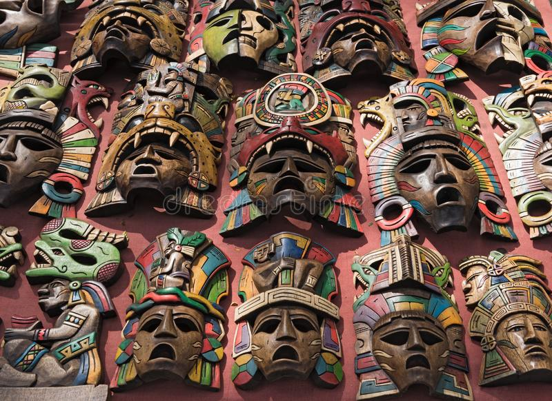 Colored wooden masks at a souvenir stand in Chichen Itza, Yucatan, Mexico royalty free stock image