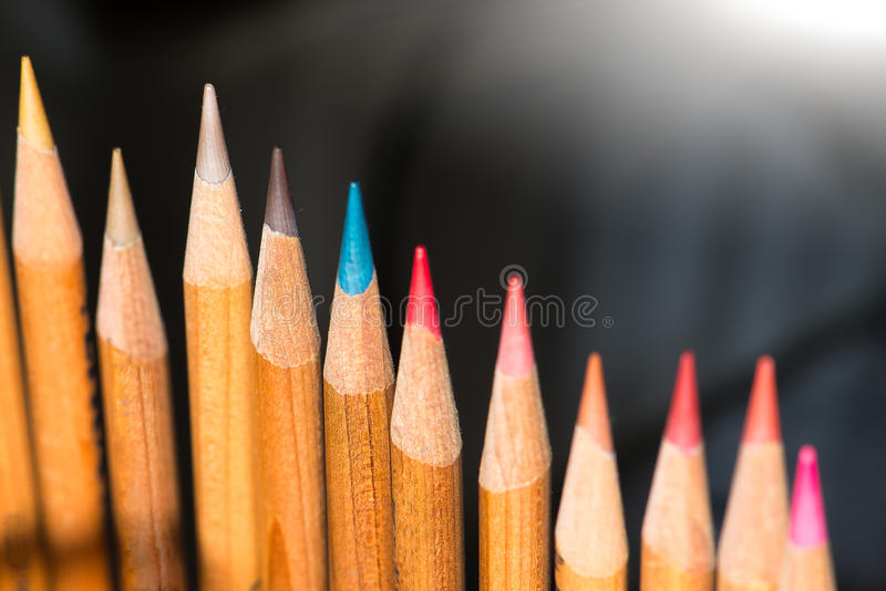 Colored wooden pencils. Details of Colored wooden pencils royalty free stock photography