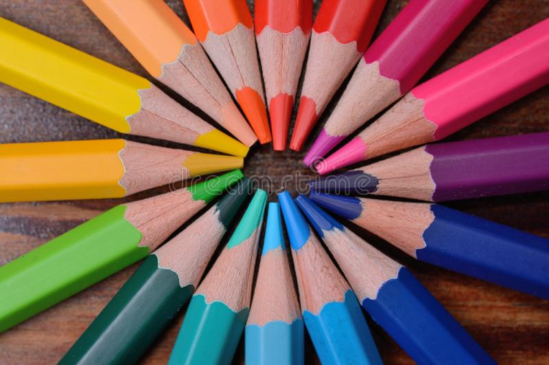 Colored wooden pencils located a circle, a close up royalty free stock photos