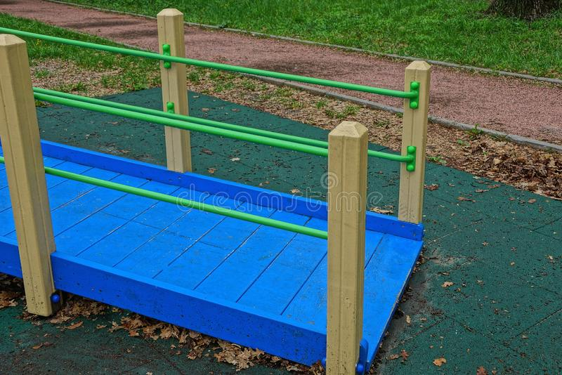Colored wooden structure with a bridge and a ladder on the playground stock photography