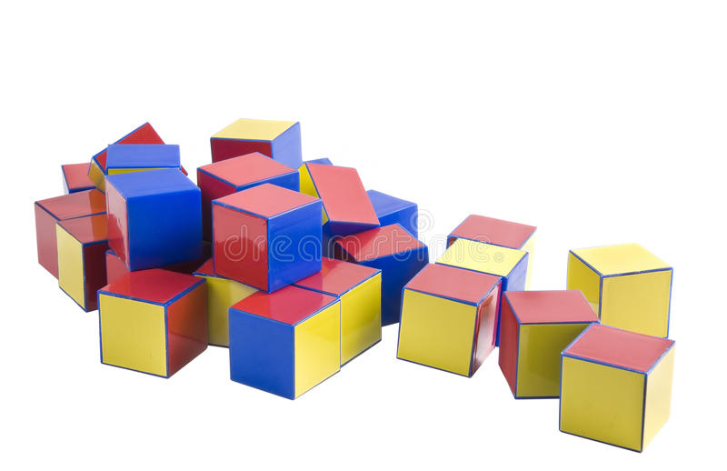 Colored wooden toys for the building. Over white background stock photos