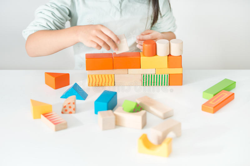 Colored wooden toys for the building. Amass a block stock images