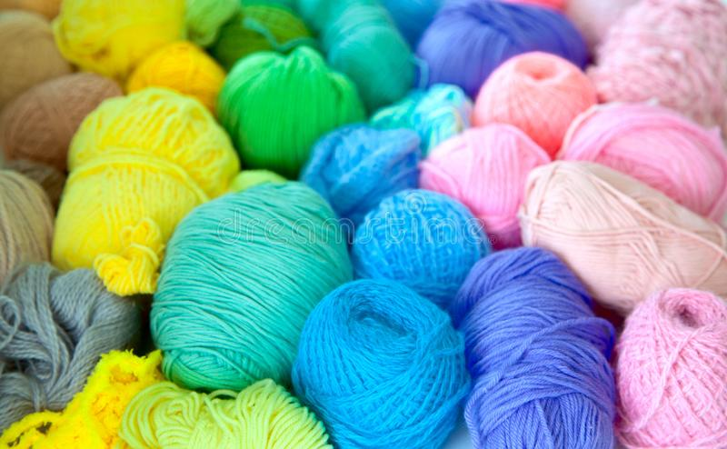 Colored balls of yarn. View from above. Rainbow colors. All colo. Colored woolen yarn. Rainbow colors. All color royalty free stock photos