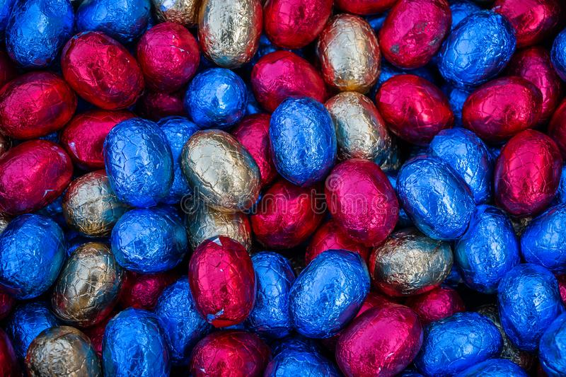Colored and wrapped easter chocolate eggs royalty free stock images