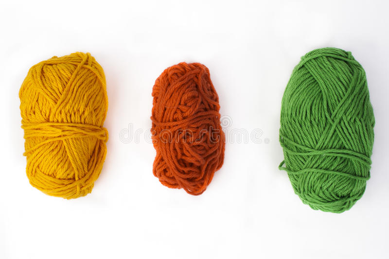 Colored Yarn Centered on White Backdrop. Three skeins of colored yarn centered and isolated on a white backdrop royalty free stock photo