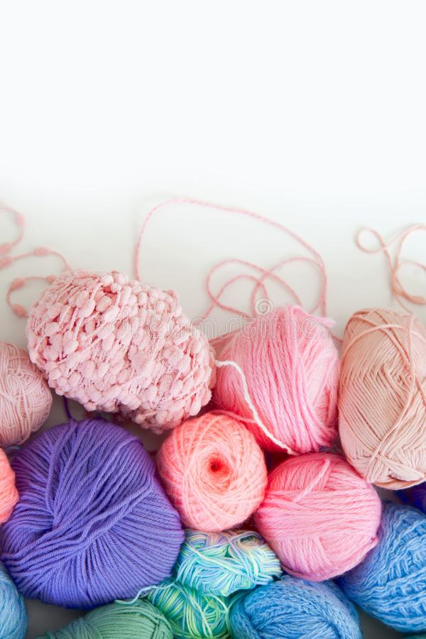 Colored yarn of iridescent hues. Woolen threads. Color yarn for knitting. Woolen threads royalty free stock photography