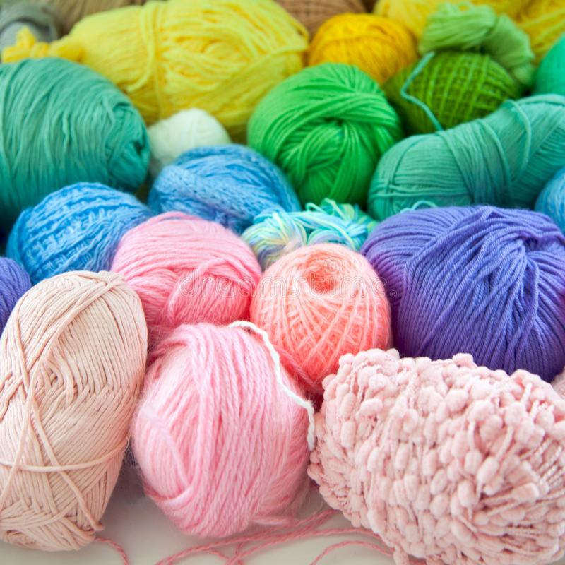 Colored yarn of iridescent hues. Woolen threads. Color yarn for knitting. Woolen threads royalty free stock images