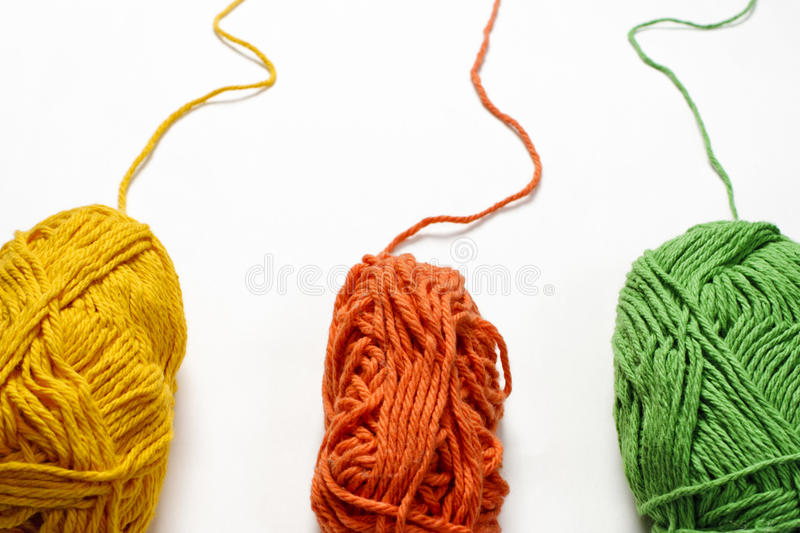 Colored Yarn on White Backdrop. Three skeins of colored yarn against a white backdrop stock photo