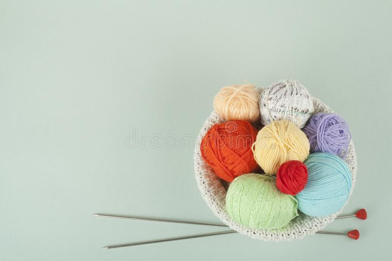 Colored yarn on a white background. Skeins of wool yarn for knitting. Balls of wool with spokes of different colours for stock images