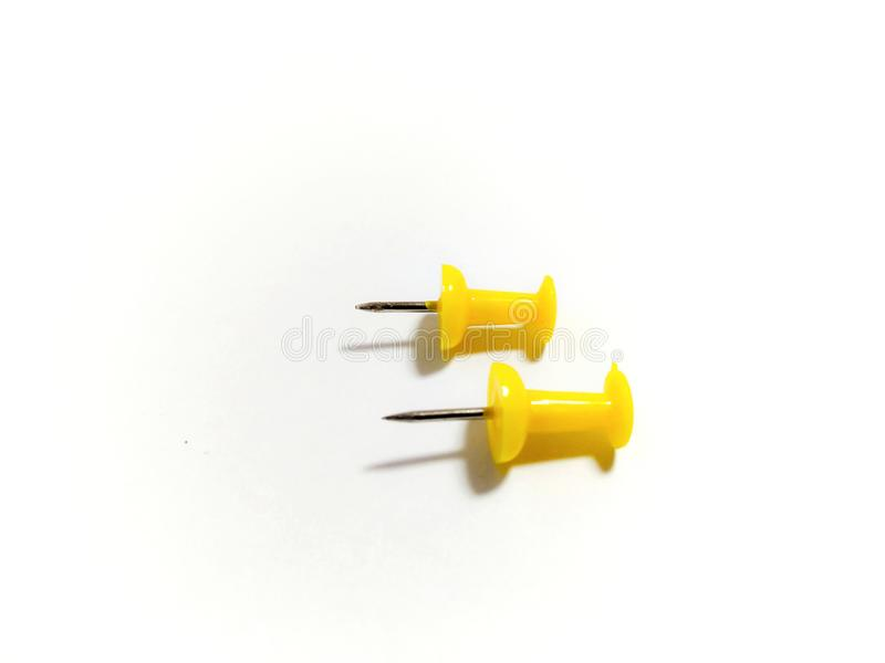 Colored yellow push pins isolated on white background royalty free stock photography