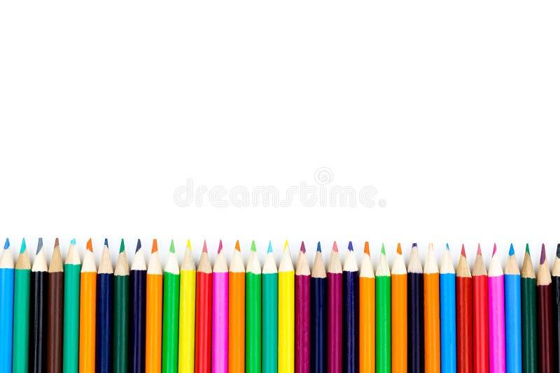 Coloree el lápiz con el espacio de la copia aislado en el fondo del whtie, educat fotos de archivo