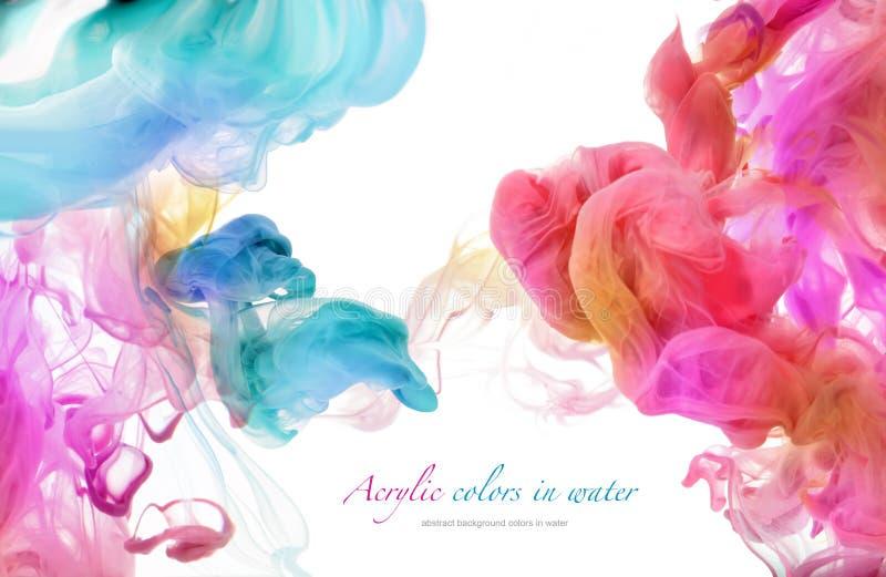 Colores de acrílico en agua imagen de archivo libre de regalías