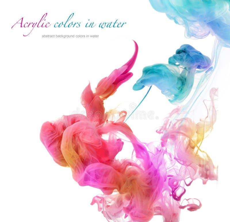 Colores de acrílico en agua fotografía de archivo