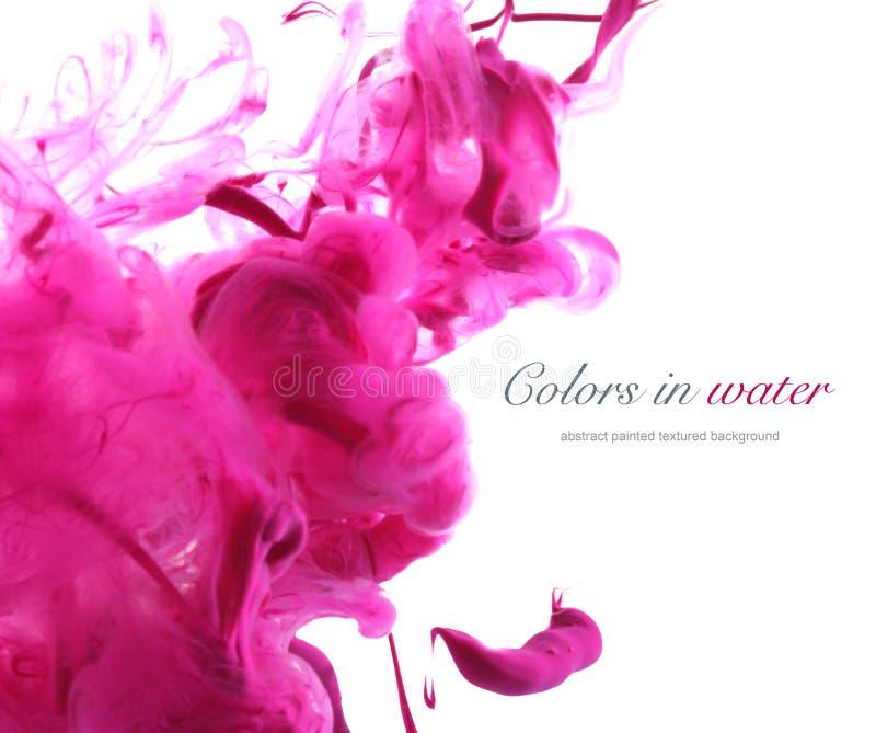 Colores de acrílico en agua abstraiga el fondo foto de archivo libre de regalías