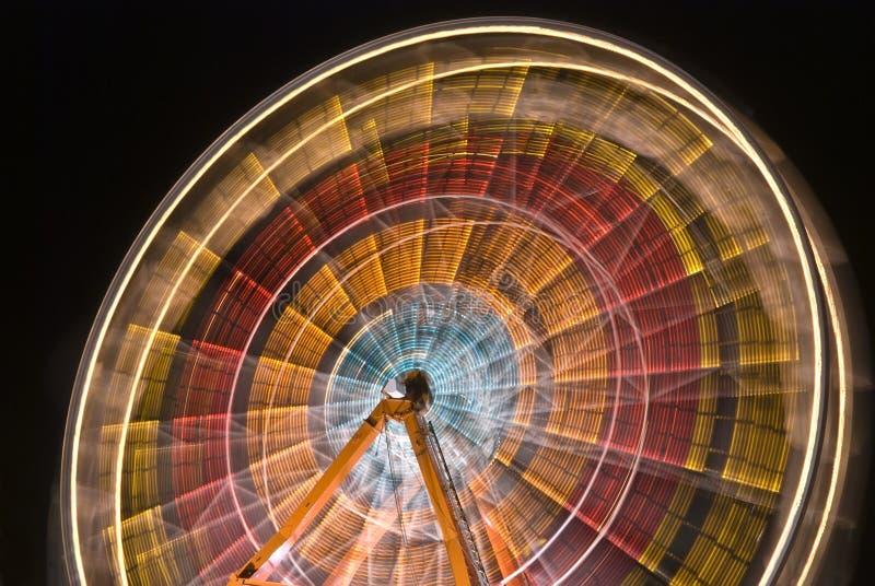 Colores de giro de la rueda de Ferris foto de archivo libre de regalías