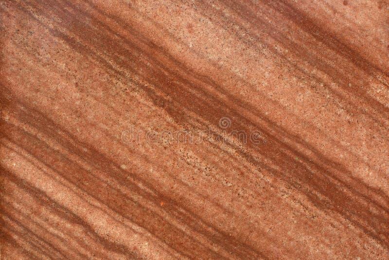 Colores de tierra calientes en el fondo de piedra imagen de archivo libre de regalías