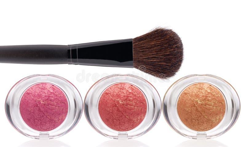 Colorete y cepillo del maquillaje foto de archivo