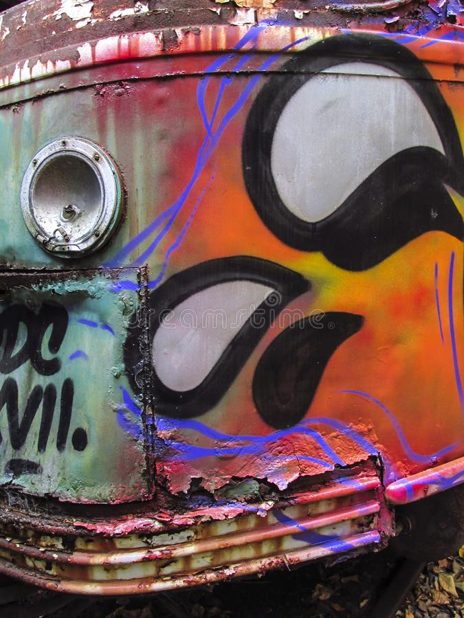 Colorful abandoned trolley car closeup in woods royalty free stock image