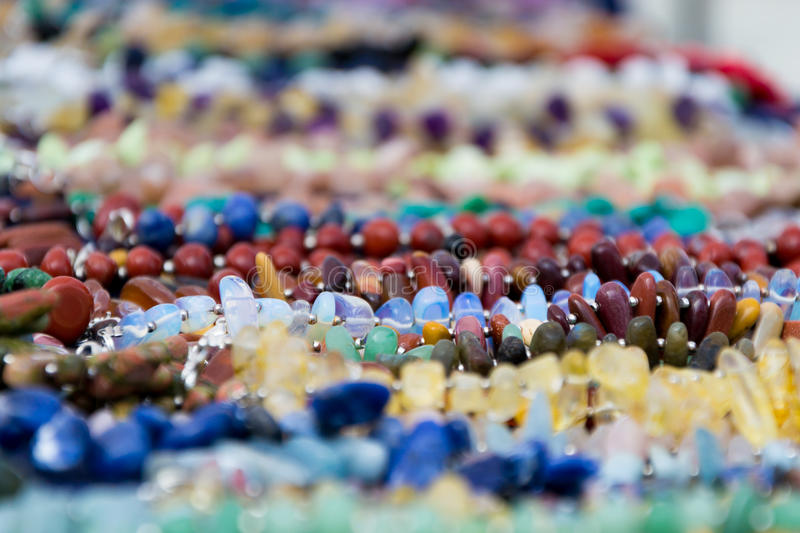 Colorful abstract background with blurred precious stones. Jewelery imitation stock image