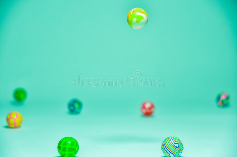 Colorful abstract background with bouncing balls. Creative abstract blur and focused green background, three dimensional outer space images with bouncing balls stock images