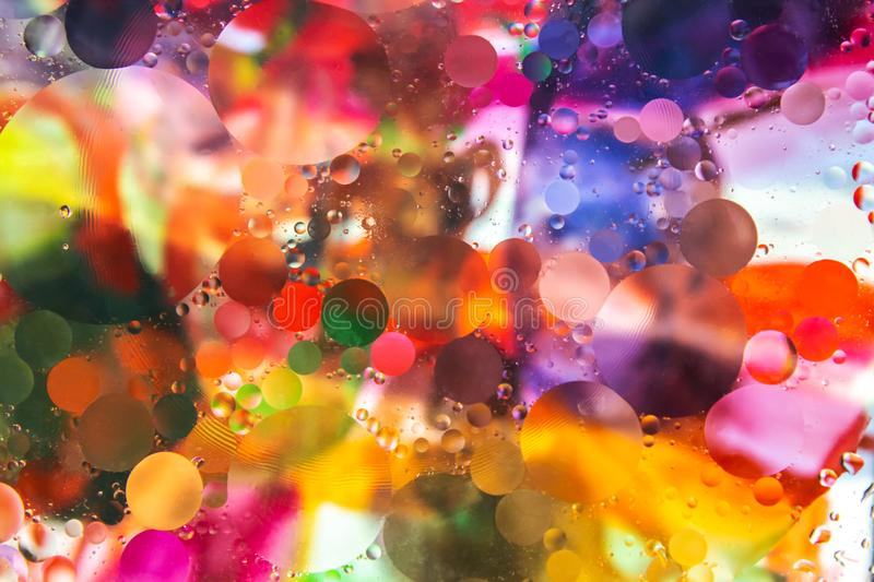 Colorful background. Drops of oil in water. Colorful abstract background from circles. Oil in water stock image