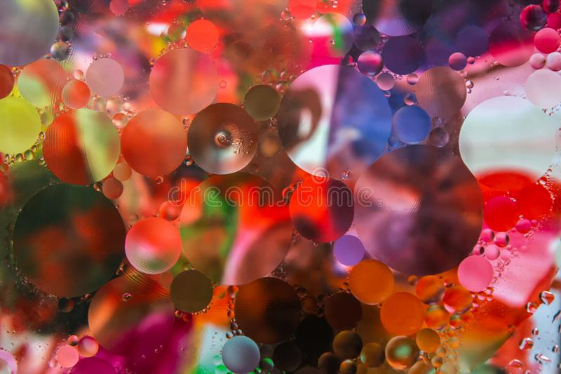 Colorful abstract background from circles. Oil in water. Oil in the water. Colorful abstract background stock photo