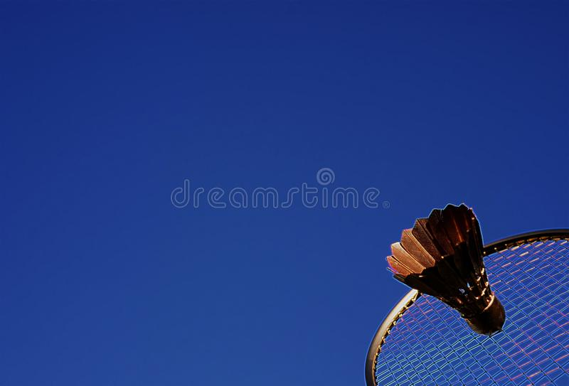 Colorful abstract badminton racket and shuttlecock sky blue. Artistic badminton racket and shuttlecock close-up. Colorful badminton memory fantasy royalty free stock photography