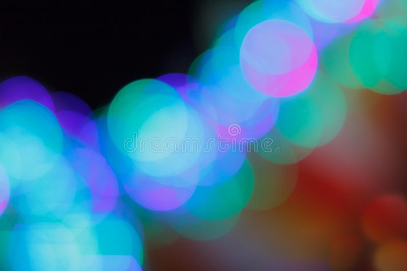 Colorful abstract blurred circular bokeh light of night city street for background. graphic design and website template royalty free stock image