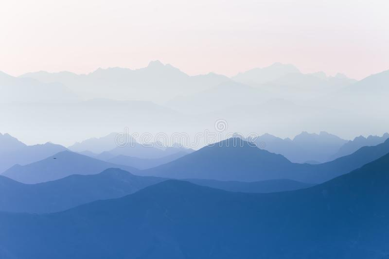 Colorful, abstract double exposure of mountains in sunrise. Minimalist scenery with color gradients. Tatra mountains in Slovakia, Europe royalty free stock image