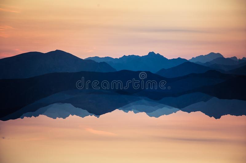 Colorful, abstract double exposure of mountains in sunrise. Minimalist scenery with color gradients. Tatra mountains in Slovakia, Europe stock photo