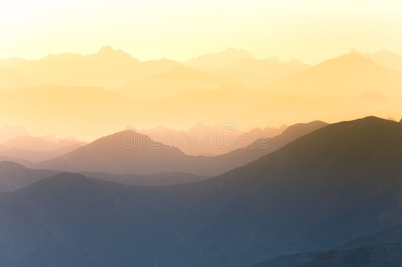 Colorful, abstract double exposure of mountains in sunrise. Minimalist scenery with color gradients. Tatra mountains in Slovakia, Europe stock photos