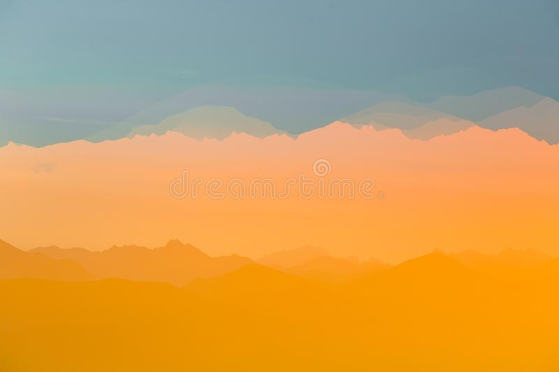 Colorful, abstract double exposure of mountains in sunrise. Minimalist scenery with color gradients. Tatra mountains in Slovakia, Europe stock photography