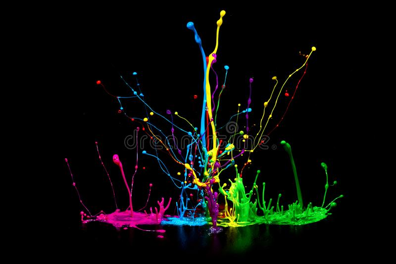 Colorful abstract paint splashing on audio speaker isolated on black background royalty free stock photo