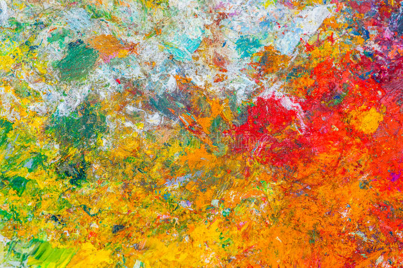 Colorful abstract pattern. Made of a dried oil paint on a surface of an artist's palette. Bright and cheerful colors stock photo