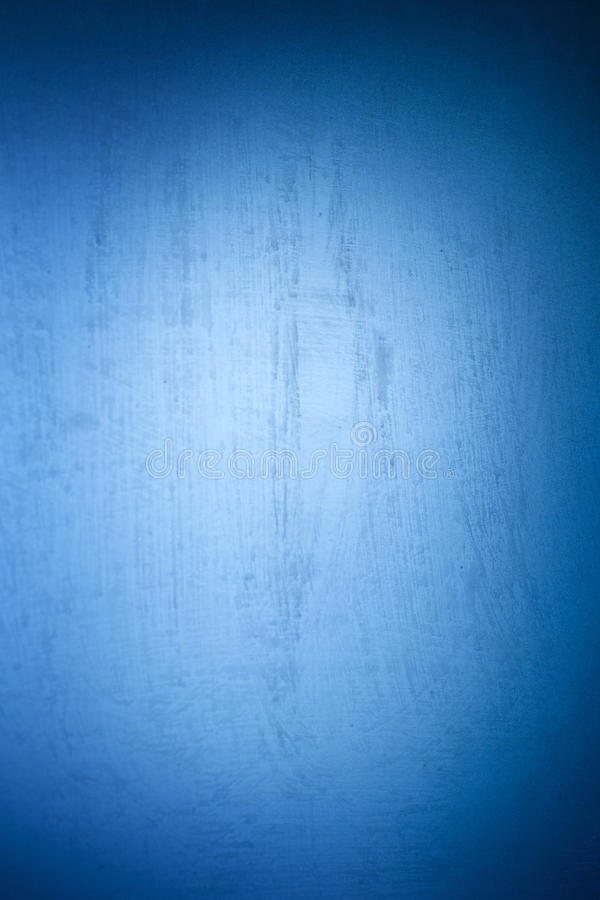 Colorful abstract smooth texture with with selective spots of paint. Blue background with vignette and bright center.  stock image