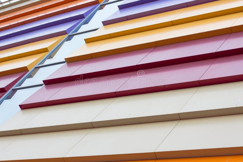 Colorful abstraction of the facade of the building. Beautiful and iridescent colors of solid metal are used in modern construction stock photos