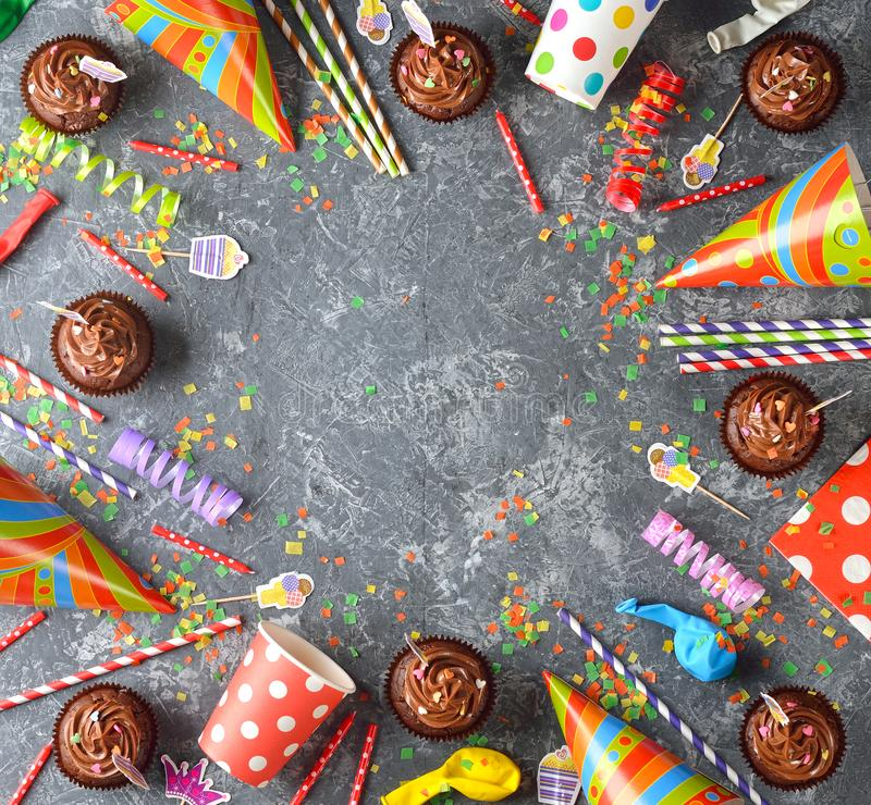 Colorful accessories for children`s parties. On a gray background royalty free stock photo