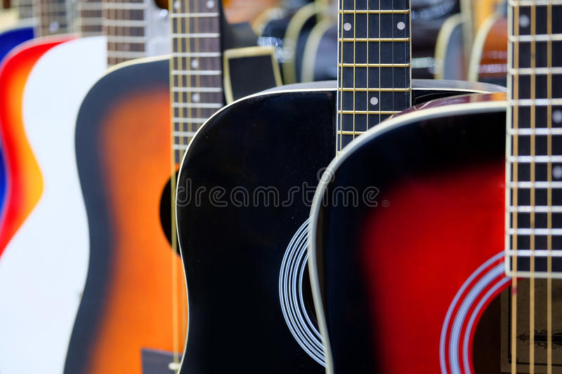 Colorful acoustic guitars stock image