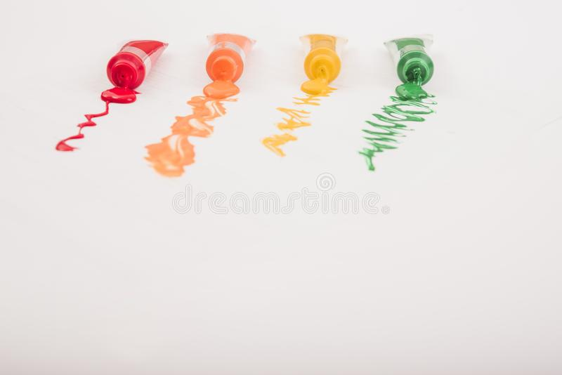 Colorful acrylic paints in tubes stock photo