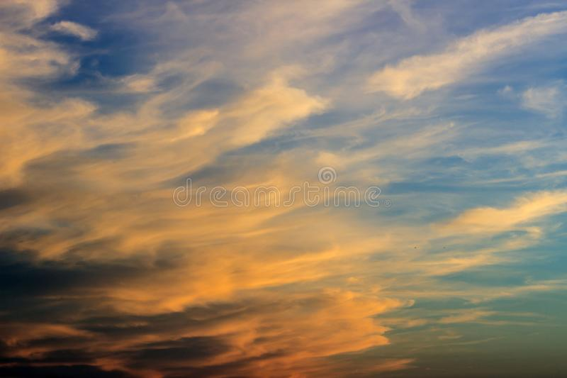 Colorful afterglow sky background with clouds. Sky in afterglowsunset, orange couds stock photography