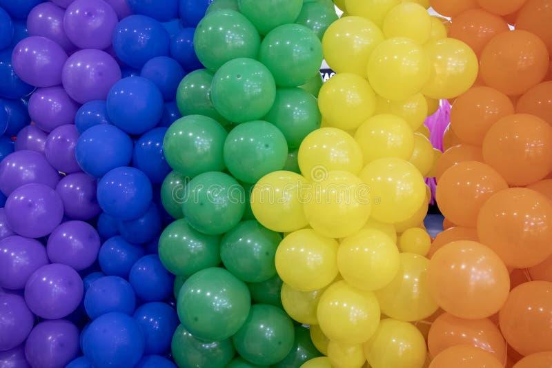 Colorful air balloon wall closeup photo. Vivid party balloon background. Festive toy balloon backdrop. stock image