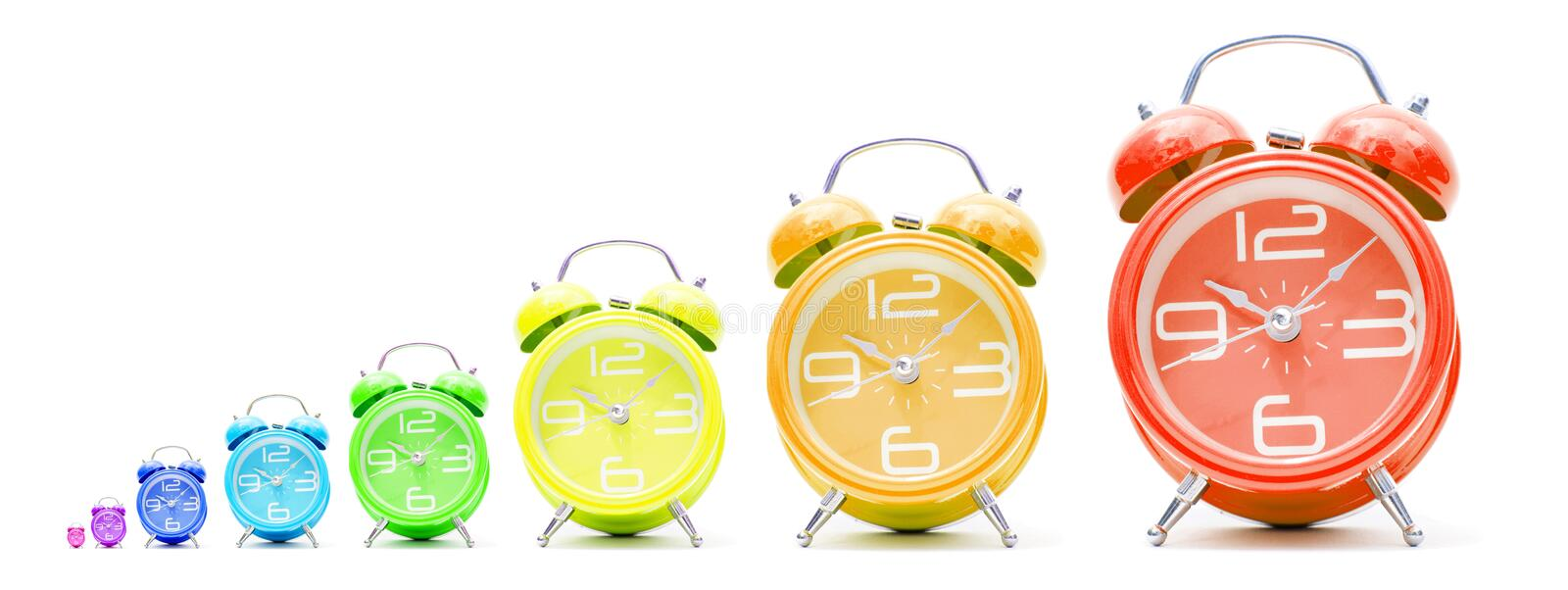 Colorful alarm clocks. A group of colorful alarm clocks in different sizes stock illustration