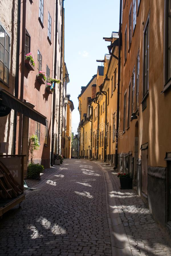 Colorful alley in historic city center of stockholm gamla stan island, Sweden royalty free stock photography