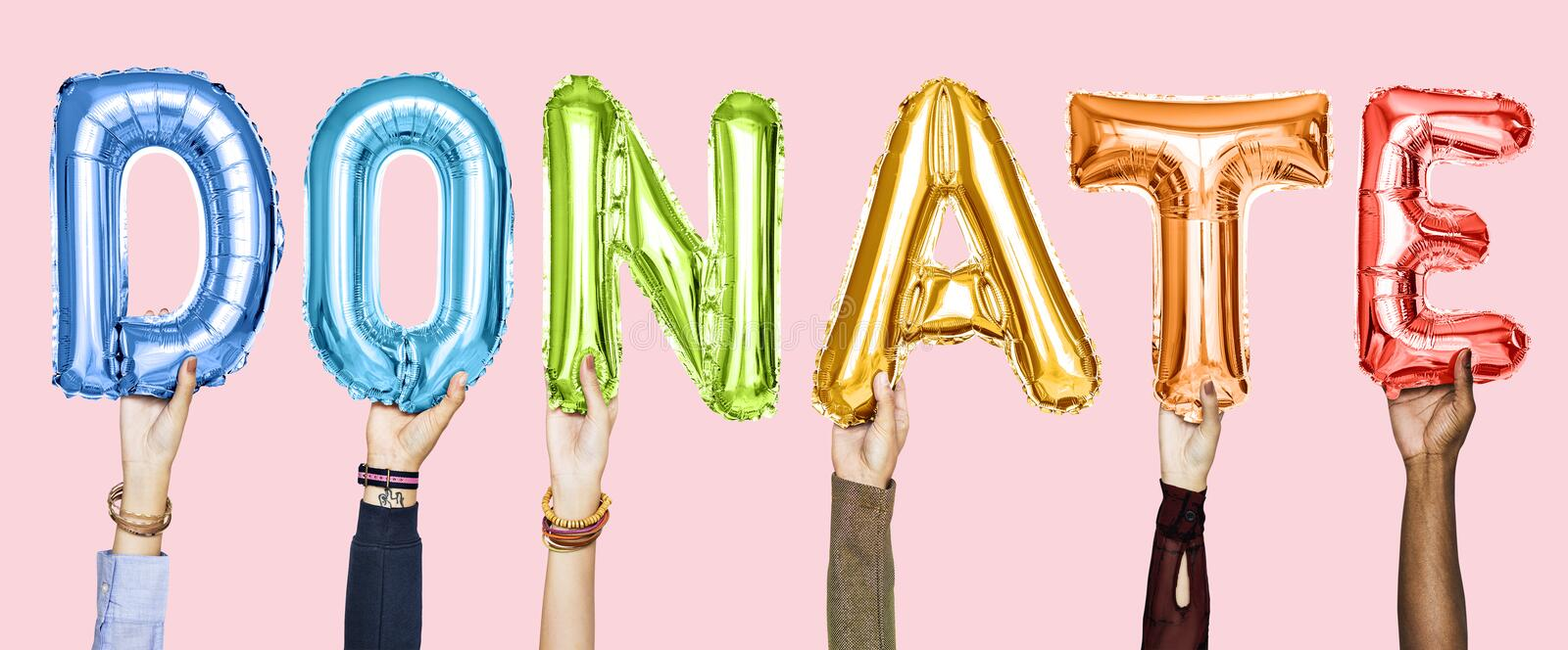 Colorful alphabet balloons forming the word donate royalty free stock images