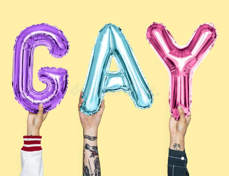 Colorful alphabet balloons forming the word gay stock images